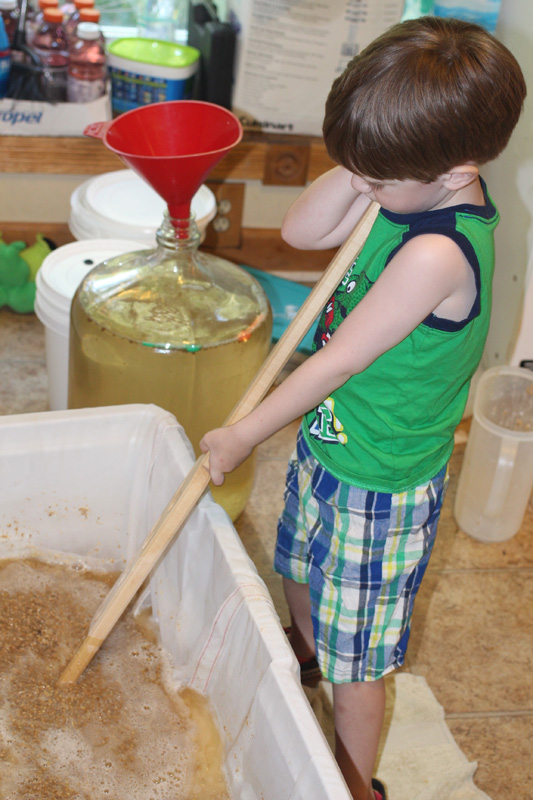 Silas stirring the mash
